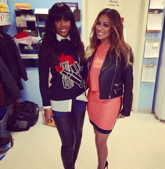InstaStyle-Kelly- Rowland-attends- LaLa- Anthony-Book- Signing-in-Stella-McCartney-Wool- And Silk-Blend- Lipstick-Intarsia- Sweater-and- Christian- Louboutin- Monicarina- Boots-3